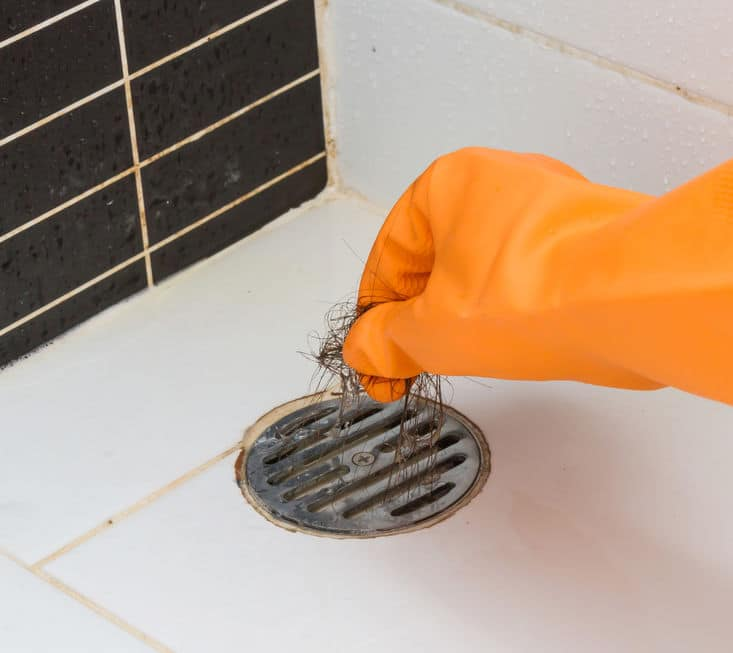 unclogging a shower drain
