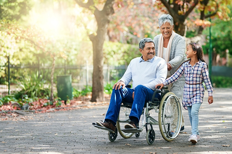 Happy grandparents with grandaughter